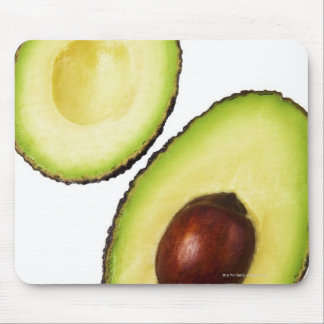 Two halves of an an avocado, on white mouse mat