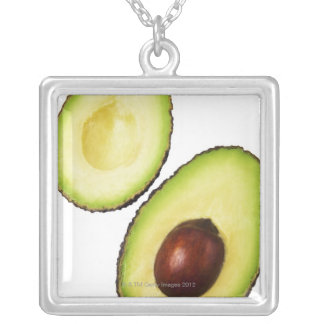 Two halves of an an avocado, on white silver plated necklace