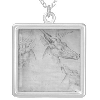 Two heads of stags, one head of a doe silver plated necklace