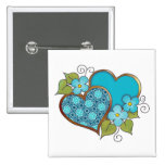 Two hearts with blossoms aqua button