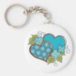 Two hearts with blossoms aqua key chains