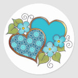 Two hearts with blossoms aqua classic round sticker