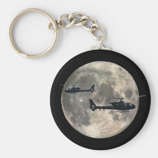 two helicopters silhouetted by a full moon key chain