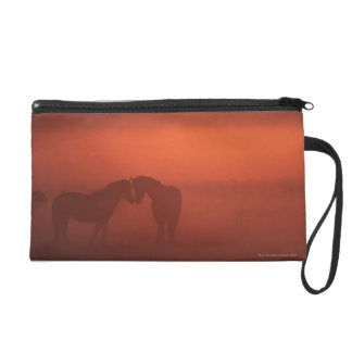 Two horses at sunset wristlet