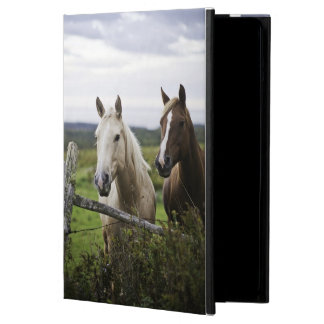 Two horses stand near fence in farm field of off iPad air cases