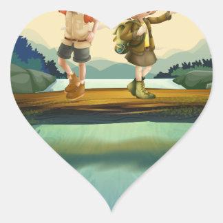 Two kids crossing the river heart sticker
