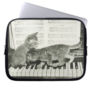 Two kitten playing on piano keyboard, (B&W) Laptop Sleeve