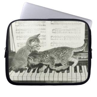 Two kitten playing on piano keyboard, (B&W) Laptop Sleeves