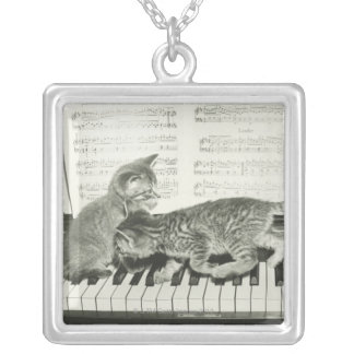 Two kitten playing on piano keyboard, (B&W) Silver Plated Necklace