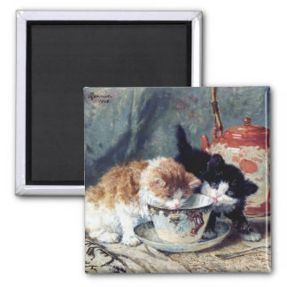 Two kittens having tea party magnet