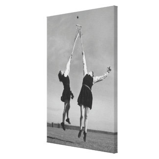 Two lacrosse players jump for the ball. canvas print
