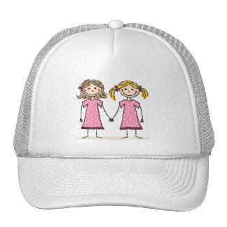Two little girls holding hands cap