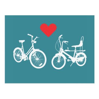 Two lovely vintage bikes find love post card