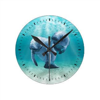 Two Manatees Swimming Wall Clock