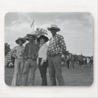 Two men and two women at a rodeo mouse pad