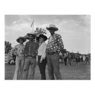 Two men and two women at a rodeo postcard