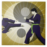 Two men performing martial arts in front of a large square tile