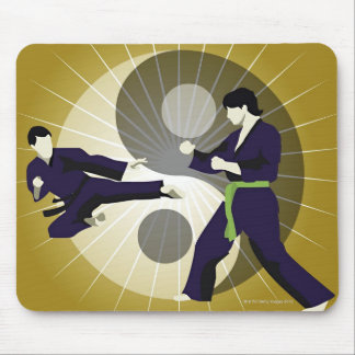 Two men performing martial arts in front of a mouse mat