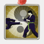 Two men performing martial arts in front of a Silver-Colored square decoration