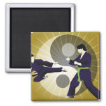 Two men performing martial arts in front of a square magnet