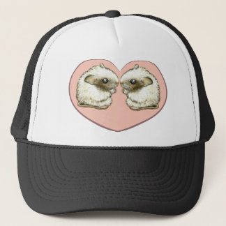 Two mice in a love heart trucker hat