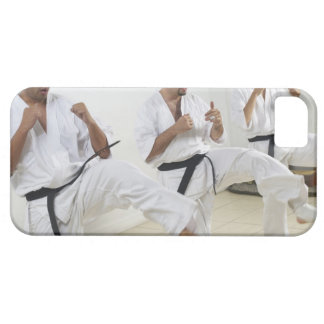 Two mid adult men with a young man practicing iPhone 5 case