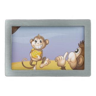 Two monkeys beside the big tree belt buckles
