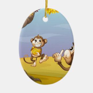 Two monkeys beside the big tree ceramic oval decoration