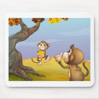 Two monkeys beside the big tree mouse pad