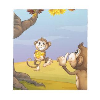 Two monkeys beside the big tree scratch pad