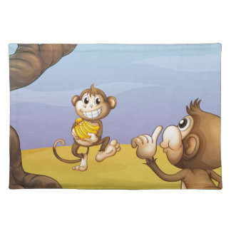 Two monkeys beside the big tree place mat