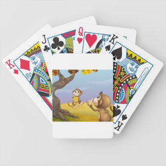 Two monkeys beside the big tree card deck