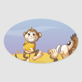 Two monkeys beside the big tree oval sticker