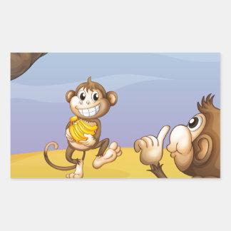 Two monkeys beside the big tree rectangular sticker
