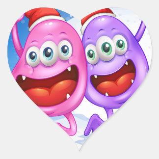 Two monsters celebrating christmas heart sticker