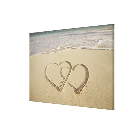 Two overlying hearts drawn on the beach stretched canvas prints