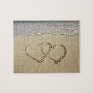 Two overlying hearts drawn on the beach jigsaw puzzle