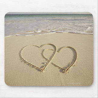 Two overlying hearts drawn on the beach mouse mat