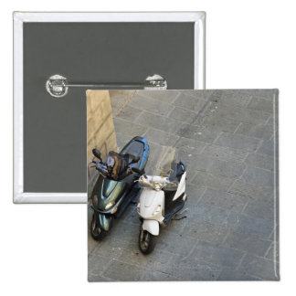 Two parked motor scooters by wall, Siena, Italy 15 Cm Square Badge