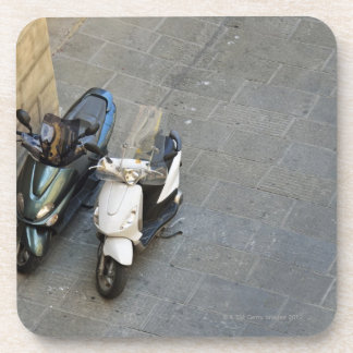 Two parked motor scooters by wall, Siena, Italy Coaster