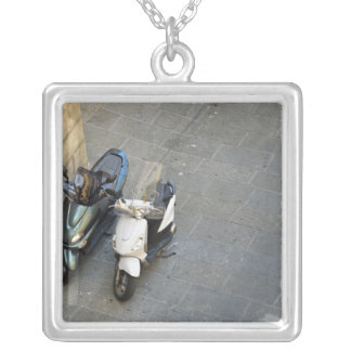 Two parked motor scooters by wall, Siena, Italy Silver Plated Necklace