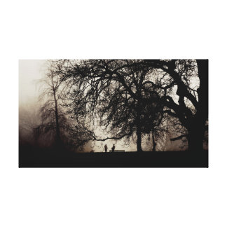 Two people meet in a misty wood canvas print