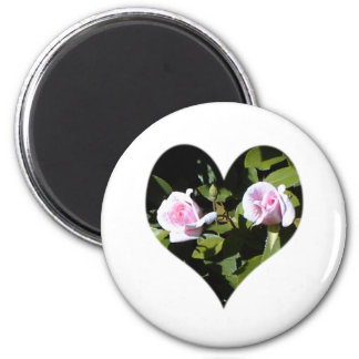 Two pink roses within a heart 6 cm round magnet