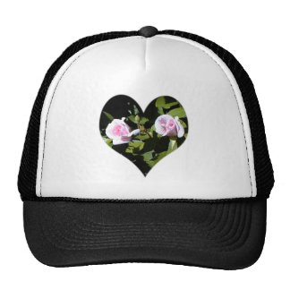 Two pink roses within a heart hats
