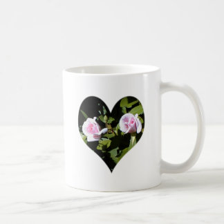 Two pink roses within a heart mugs