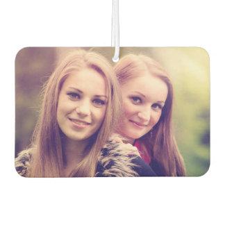Two pretty girls portrait car air freshener