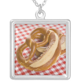 Two pretzel on checkered tablecloth silver plated necklace