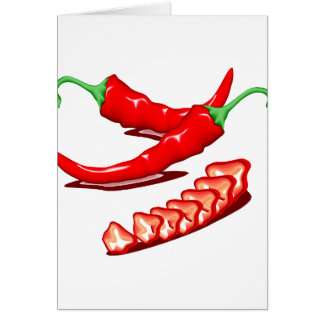 Two red chili peppers one cut up also note card