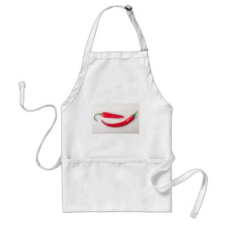 Two red hot chili peppers closeup standard apron
