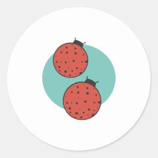 two round little ladybugs round sticker